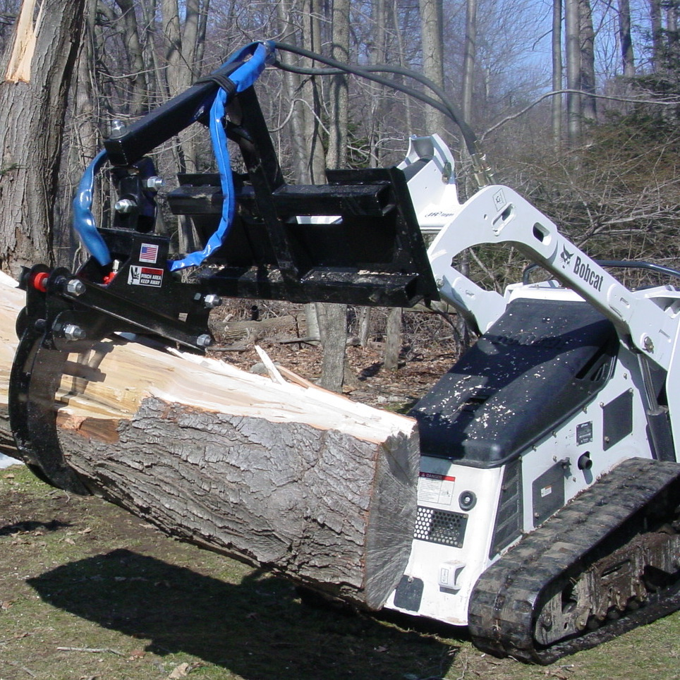 Bobcat with a Branch Manager Grapple (BMG)