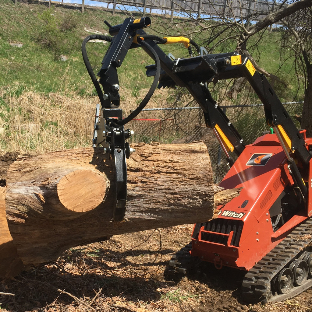 Ditch Witch with a Branch Manager Grapple (BMG)